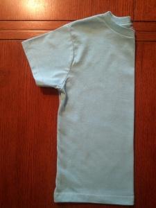 Turn a T-Shirt into a Bolero Jacket. Step One - Fold T-Shirt in Half